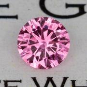 0.65 ct. Orangy-Pink Sapphire