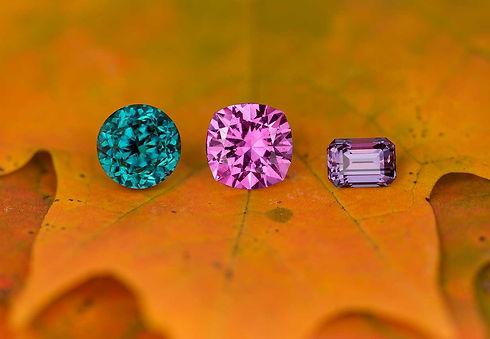 Custom cut, rare gems:  grandidierite, pink sapphire, and alexandrite