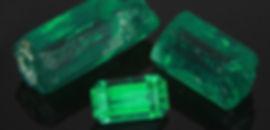 Emeralds, both rough and custom-cut