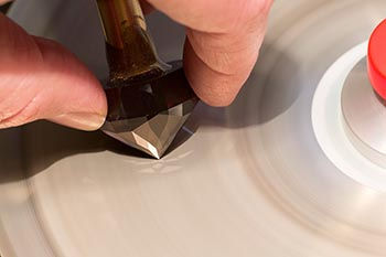 Jeff White polishing a precision cut Tanzanite