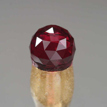 Garnet sphere, during cutting