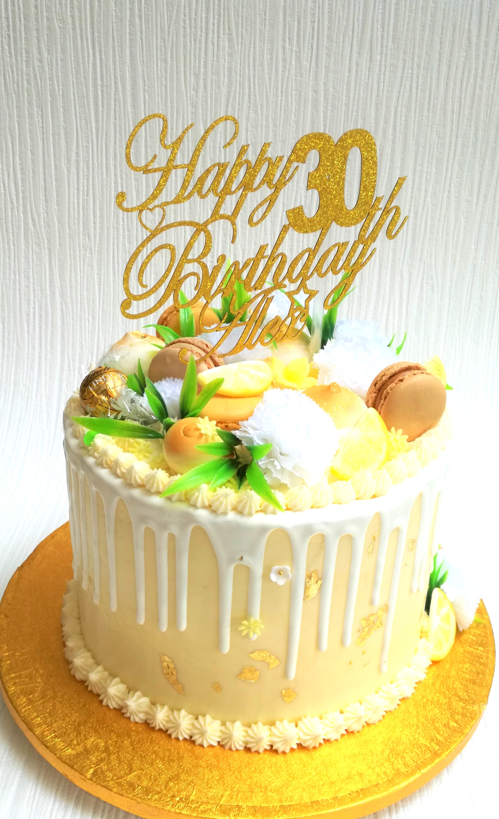 Lemon drip birthday cake
