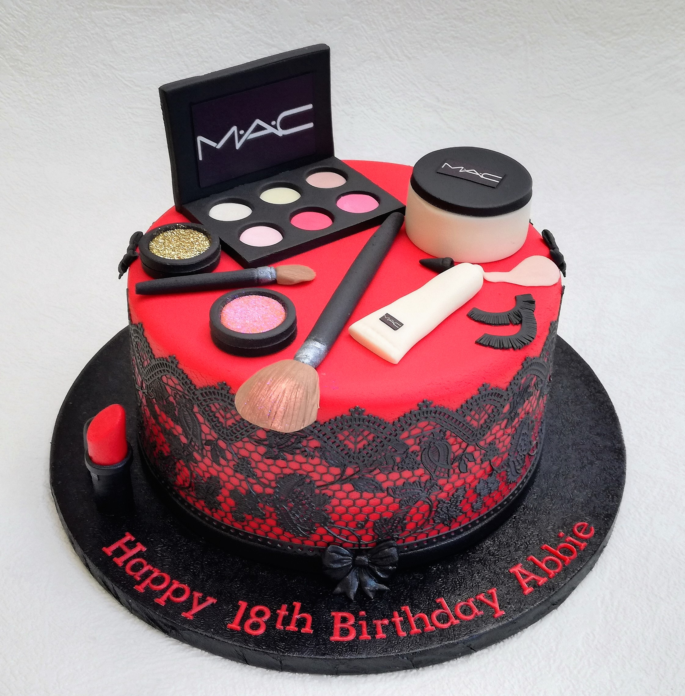 Red MAC makeup cake