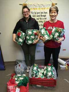 PK and Donna with packages for nursing homes