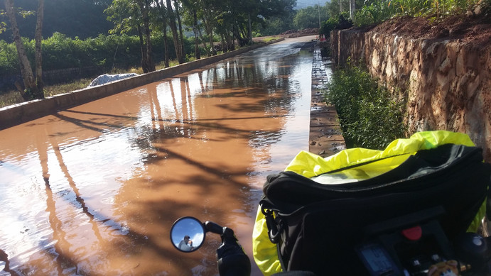 Walking the tightrope around flooded roads, Yunnan