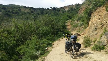 Taking a 'shortcut' up a steep goat path, Yunnan