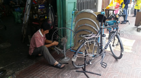 Getting the Duchess tuned up at a back alley bike shop in Bangkok