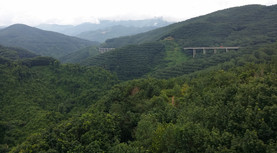 The highway was one bridges between the mountains, my route was to follow the back roads up and down each successive pass, Yunnan