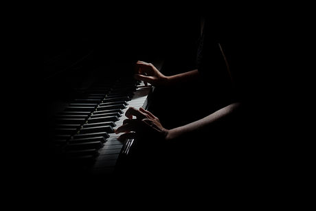 Piano player. Pianist hands playing gran
