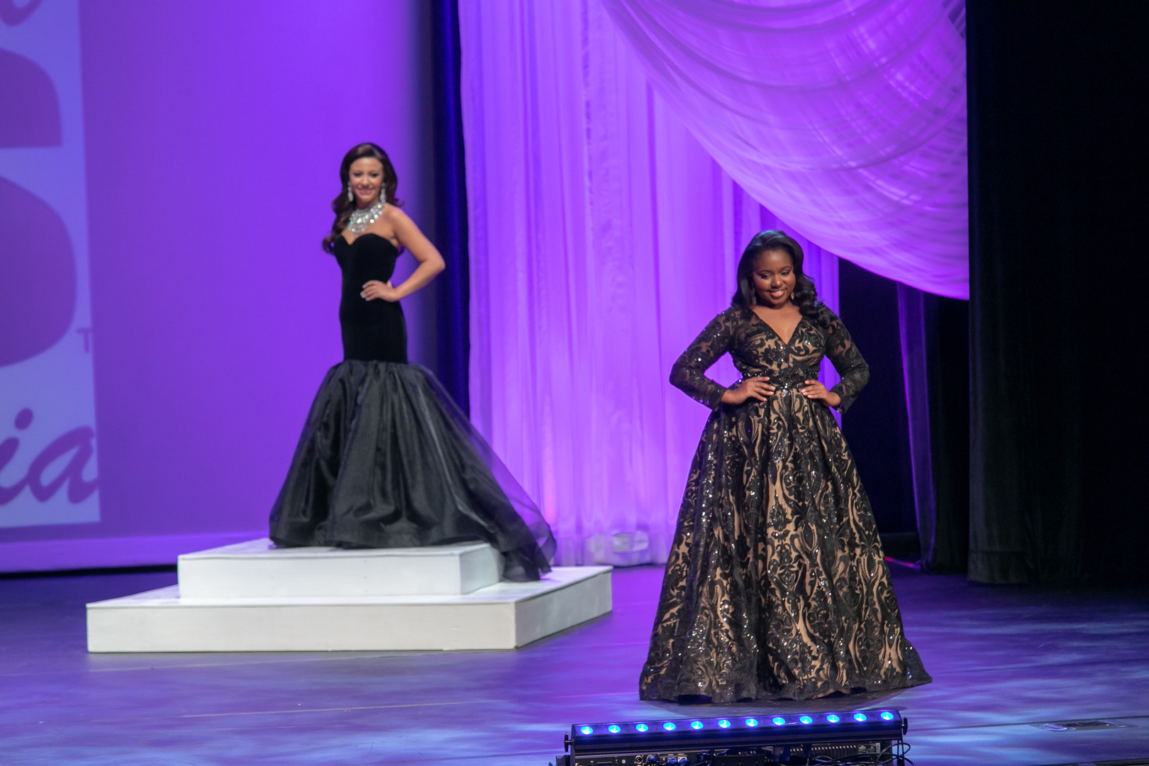 Asia competing in evening gown