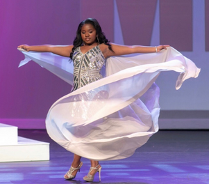 Asia competing in fashion runway.