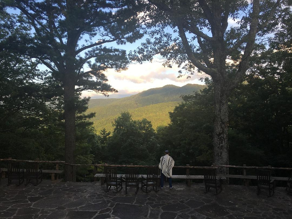 Photo courtesy of Rabbi Lucy Dinner of me praying Shacharit (the morning service) at Wildacres in the North Carolina mountains