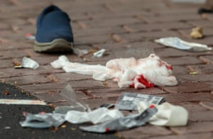 Blood-stained bandages outside the Al-Noor Mosque