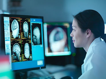 Doctor viewing brain scans on a computer
