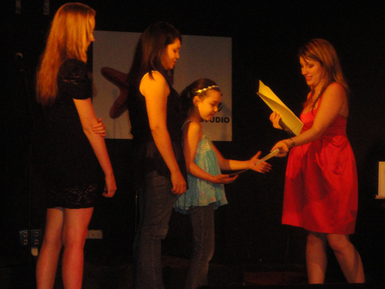 Ali giving EOY Certificates