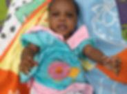 Ugandan baby smiling