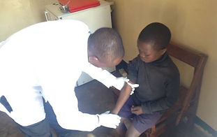 Ugandan boy at a doctor's office