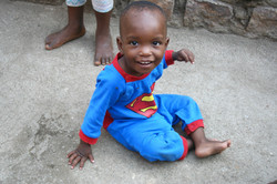 Ugandan baby in superman outfit