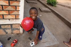 Ugandan boy holding a balloon