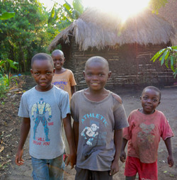 Ugandan children smiling outside