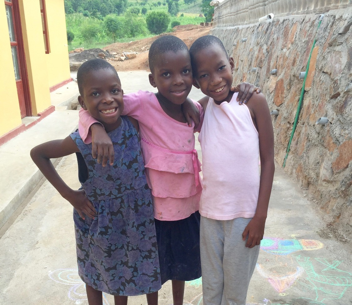 3 Ugandan girls smiling