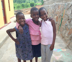 3 Ugandan girls smiling