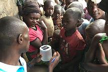 Ugandan family with new solar light