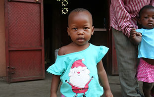 Ugandan girl with cute shirt and smile