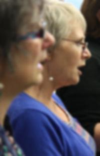 Singers rehearsing