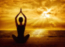 Meditating-women-on-beach-at-sunset.jpeg