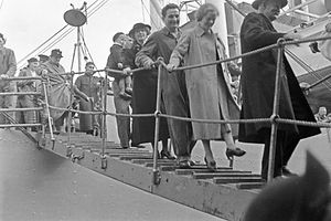 Passengers leaving docked ship.jpg