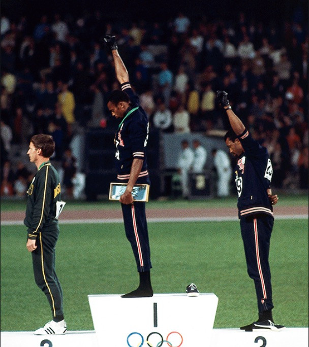 Tommie Smith and John Carlos raise a black gloved fist on the podium of the 1968 Olympics in Mexico.