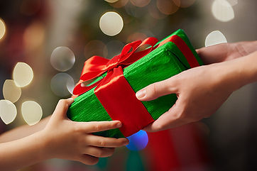 parent-giving-christmas-gift-to-child.jp