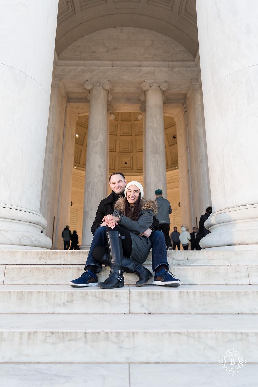 Washington D.C. Thomas Jefferson Memorial surprise sunset engagement happy engaged couple sitting on memorial steps