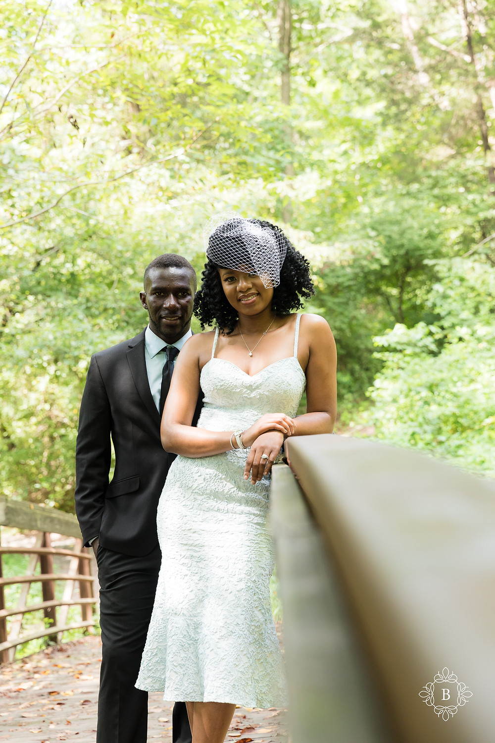 Engaged couple all smiles on the Creek Trail bridge in Ellanor C. Lawrence park.