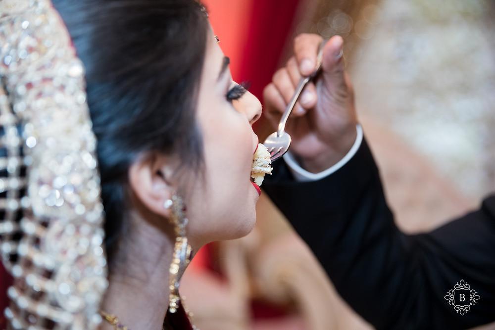 Northern Virginia Desi South Asian Cherry Blossom Restaurant wedding reception cake cutting