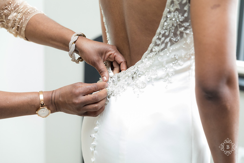 Northern Virginia Culpeper Center and Suites bridal prep zipping up the wedding dress