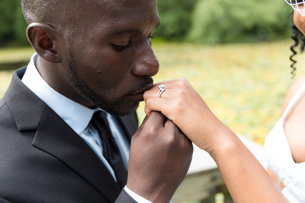 A kiss for his queen during engagement session at Walney Pond in Ellanor C. Lawrence park.