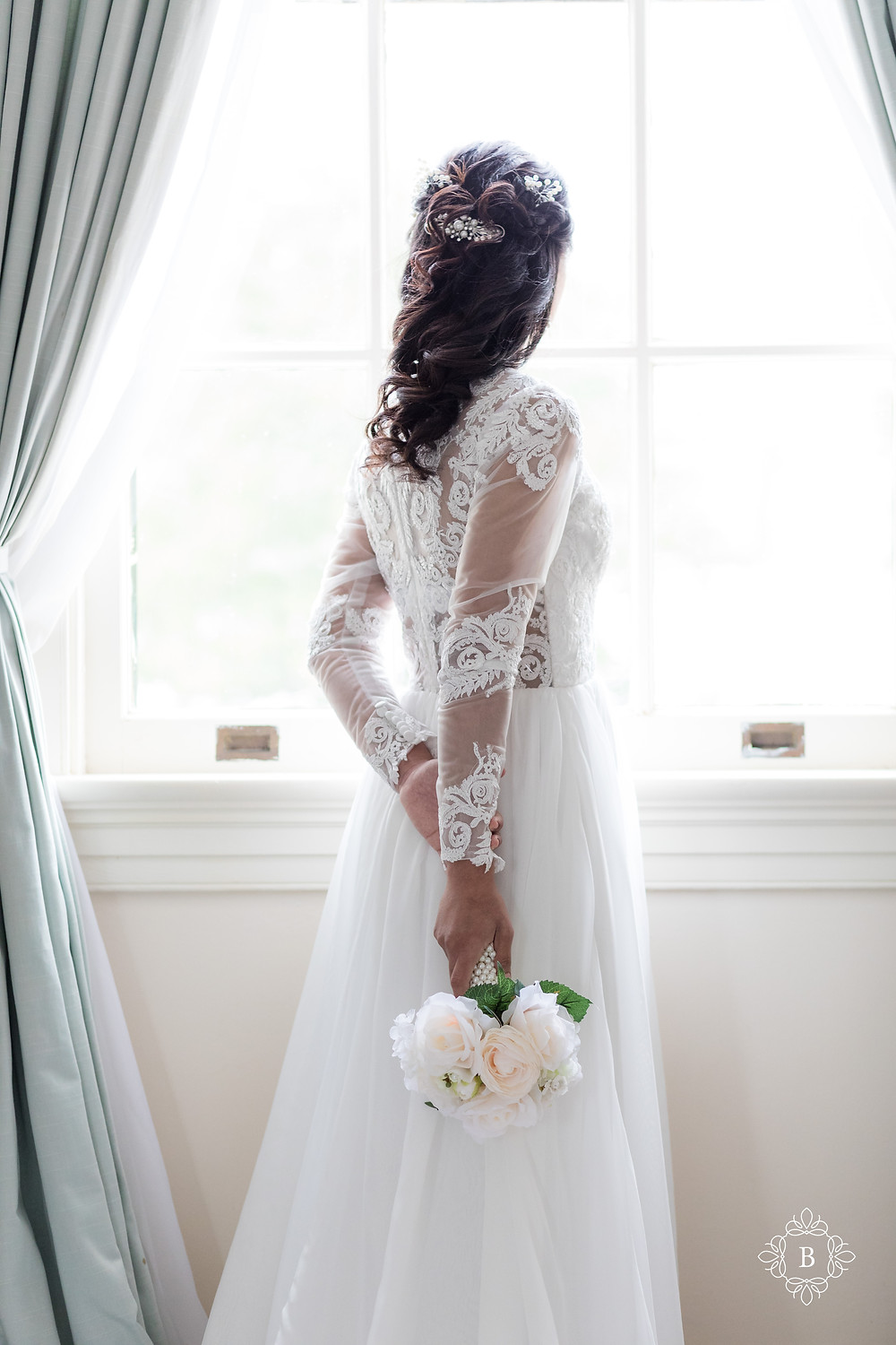 Rust Manor House bride prep elegant dress bride looking out window