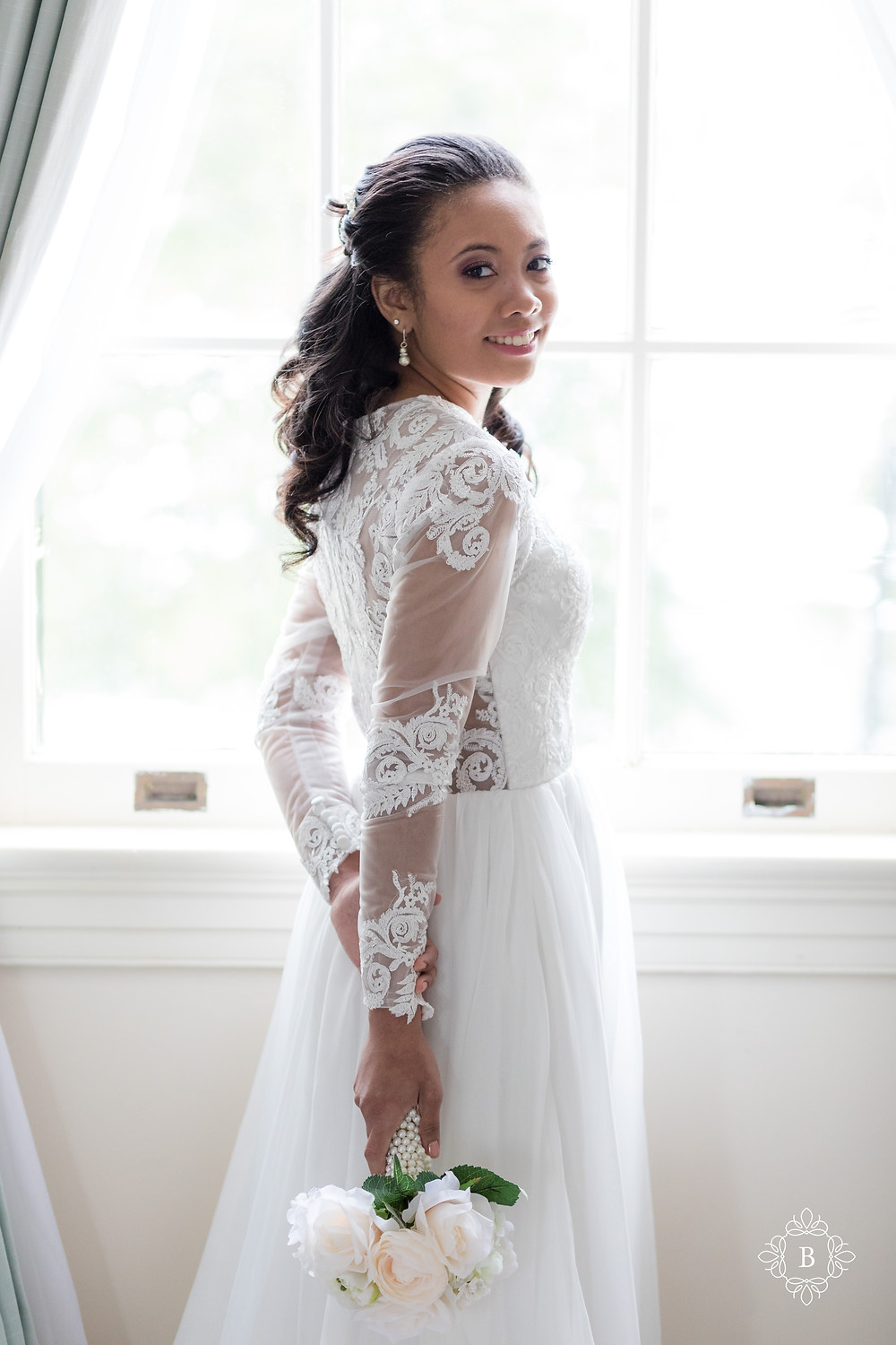 Rust Manor House bride prep elegant dress bride smiling