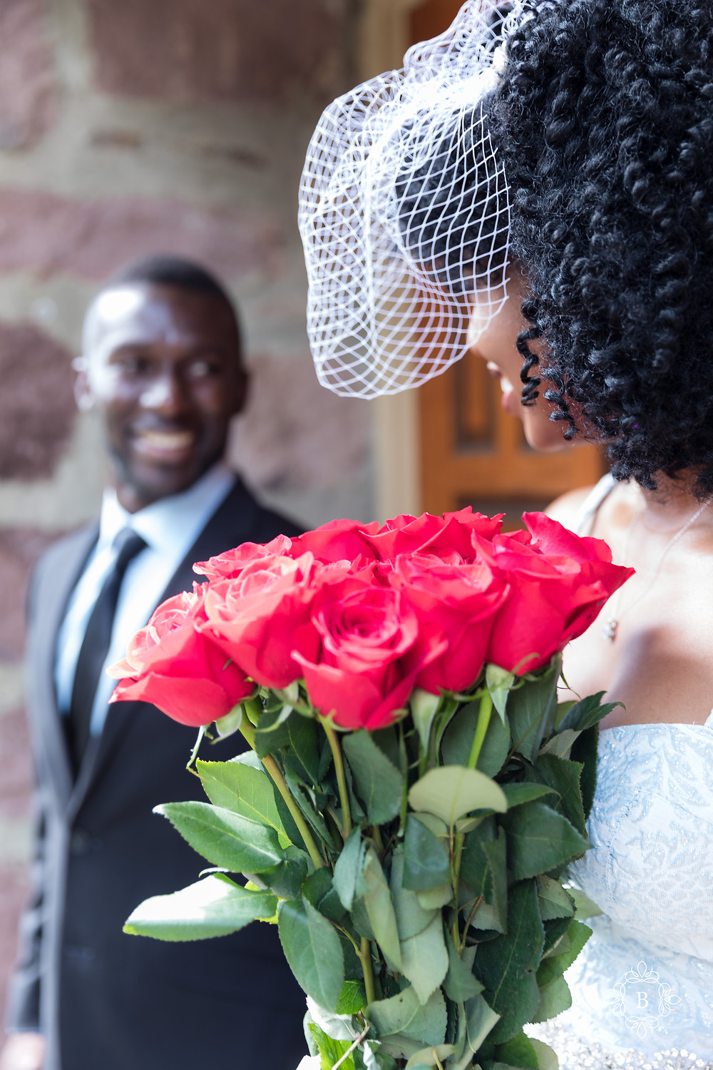 Engagement session all smiles with roses at Cabell's Mill