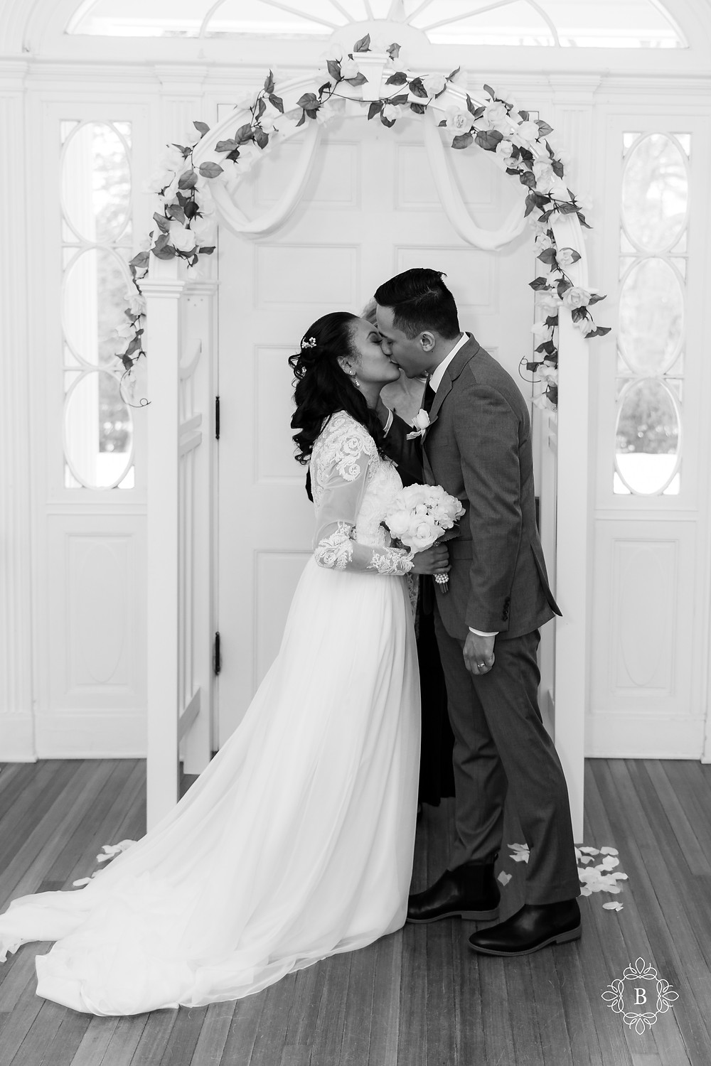 Rust Manor House wedding bride and groom first kiss