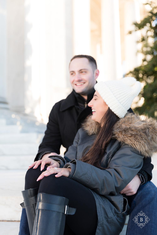Washington D.C. Thomas Jefferson Memorial surprise sunset engagement happy engaged couple sitting on memorial stairs