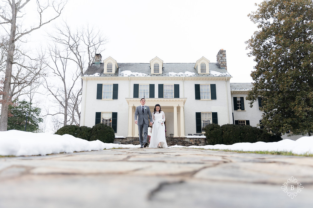 Rust Manor House wedding newly weds walking in the snow