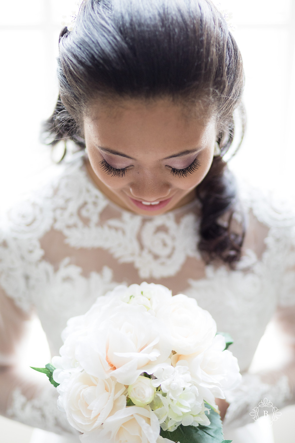 Rust Manor House bride prep bride smiling holding bouquet