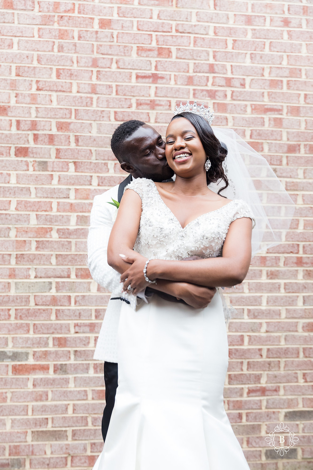 Northern Virginia Culpeper Center and Suites wedding party portraits bride and groom hugging portrait
