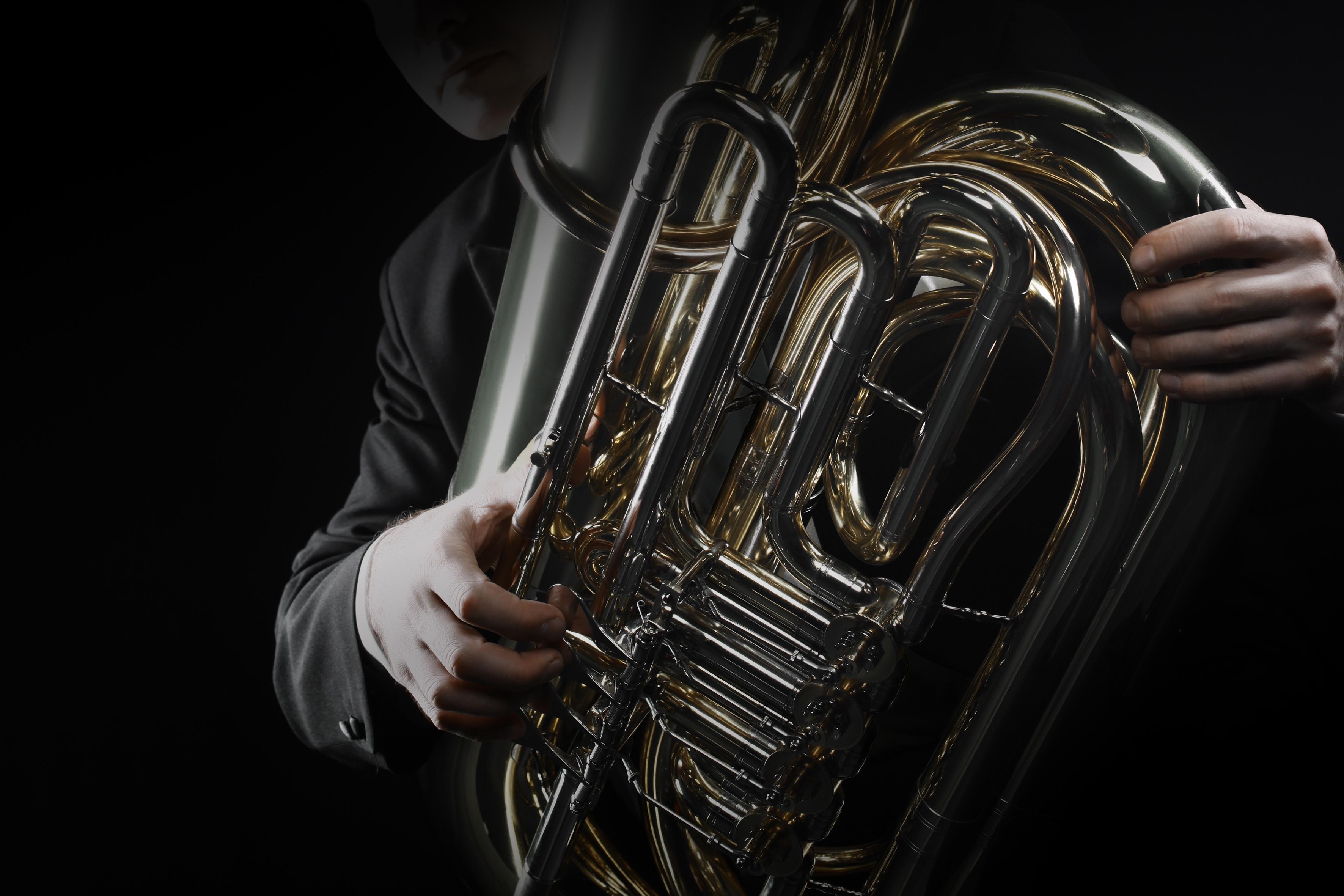 Tuba brass instrument. Wind music horn player