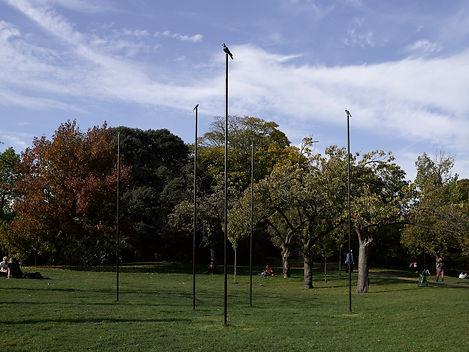 bronze sculpture with 5 birds on 12 foot poles