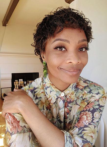 woman smilin gin a floral shirt