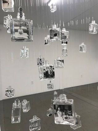 installation featuring hanging glass bottles
